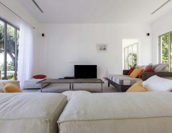 villa-aurora-lefkada-lefkas-afteli-open-living-lounge-area-tv-coffee-table-pool-view