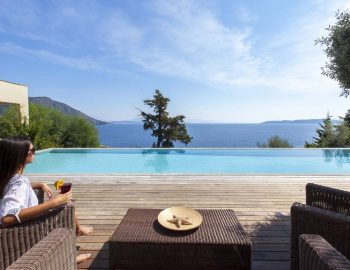 villa-aurora-lefkada-lefkas-afteli-outdoor-area-deck-pool-sea-view-girl-seating