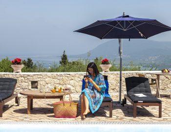 villa-four-seasons-family-villa-lefkada-greece-girl-outdoor-dining