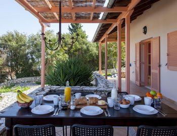 villa-four-seasons-katouna-lefkada-greece-outdoor-dining-garden-view