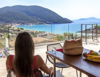villa-maria-vasiliki-lefkada-lefkas-accommodation-girl-outdoor-dining-balcony-area