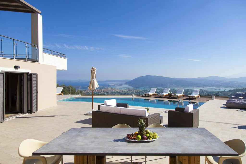 villa-melia-apolpena-lefkada-outdoor-dining-sea-view-feature-photo