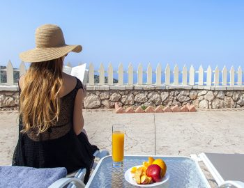 villa-vissala-paeonia-accommodation-lefkada-lefkas-xortata-private-pool-girl-sitting-on-sunbed-reading-book