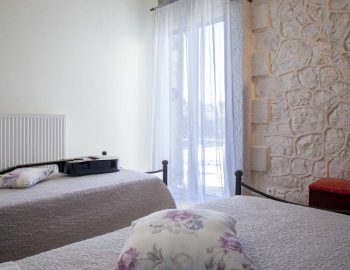 Villa-Aliki-in-tsoukalades-lefkada-greece-bedroom-with-two-beds-and-private-balcony