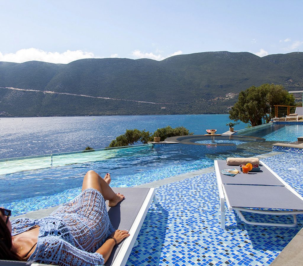 vasiliki-bay-suites-lefkas-greece-sea-view-girl-on-sunbed-cover-photo