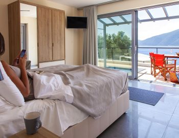vasiliki-boutique-suites-girl-in-bed-with-plunge-pool-view
