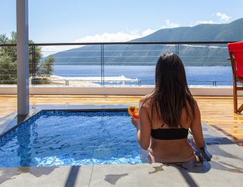 vasiliki-boutique-suites-greece-girl-in-plunge-pool-with-sea-view