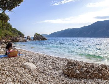 vasiliki-boutique-suites-lefkada-greece-girl-sitting-on-beach