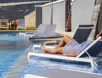 vasiliki-boutique-suites-lefkada-greece-infinity-pool-girl-on-sunbed
