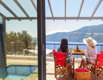 vasiliki-lefkada-boutique-suites-plunge-pool-girls-sitting-on-balcony-looking-at-sea-view