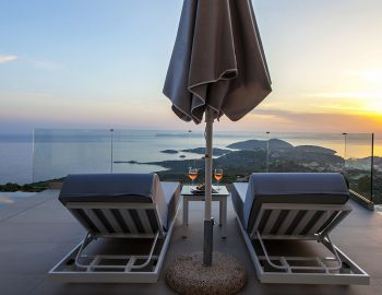 villa-achilles-sunset-sivota-epirus-greece-sunbeds-umbrella-with-sunset-view