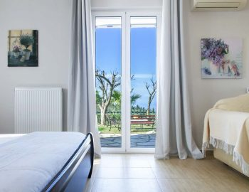 villa-aliki-tsoukalades-lefkada-master-bedroom-with-garden-view