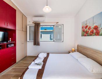 villa-alkea-nidri-lefkada-greece-master-bedroom-with-wardrobes-and-tv