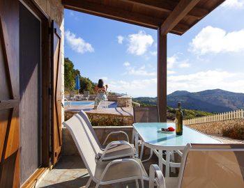 villa-arenaria-chortata-lefkada-greece-balcony-table-with-pool-view