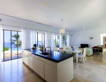 villa-aurora-lefkada-lefkas-afteli-open-living-area-lounge-dining-kitchen-sea-pool-view