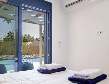 villa-galini-mikros-gialos-lefkada-greece-double-bedroom-with-pool-view