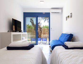villa-galini-mikros-gialos-lefkada-greece-twin-bedroom-with-sofabed-smart-tv-pool-access