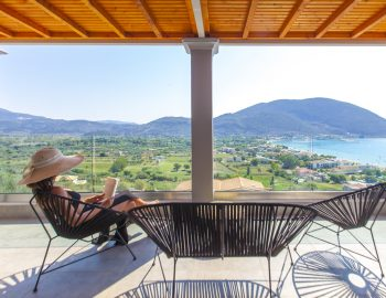 villa-irene-vasiliki-lefkada-lefkas-private-balcony-girl-overlooking-sea-view
