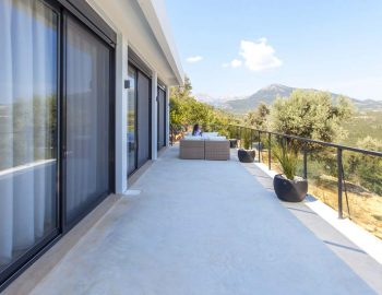 villa-luxe-sivota-lefkada-lefkas-outdoor-seating-area-girl-sitting-garden-view