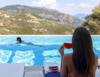 villa-luxe-sivota-lefkada-lefkas-pool-area-girl-eating-watermellon-girl-swimming-sea-views