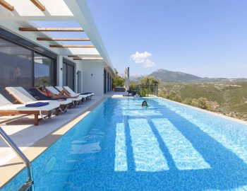 villa-luxe-sivota-lefkada-lefkas-pool-area-sunbathing-sunbed-girl-diving-mountain-view
