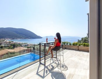 villa-maria-vasiliki-lefkada-lefkas-accommodation-girl-having-beverage-over-pool-area