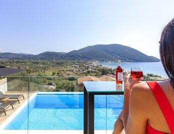 villa-maria-vasiliki-lefkada-lefkas-accommodation-girl-having-wine-pool-view