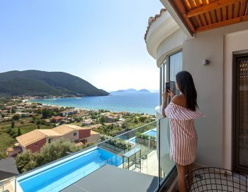 villa-maria-vasiliki-lefkada-lefkas-accommodation-girl-on-private-balcony-pool-sea-view