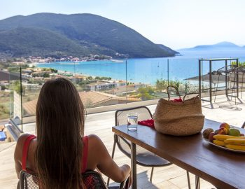 villa-maria-vasiliki-lefkada-lefkas-accommodation-girl-outdoor-dining-balcony-area