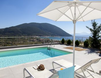 villa-o-offwhite-vasiliki-lefkada-greece-outdoor-sun-bed-with-umbrella-and-sea-view