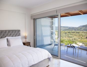 villa-o-offwhite-vasiliki-lefkada-greece-upper-level-master-bedroom-with-private-balcony-and-mountain-view