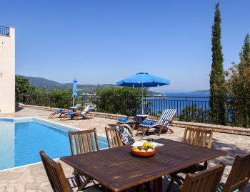 villa-poseidon-nikiana-lefkada-greece-dining-table-pool-area