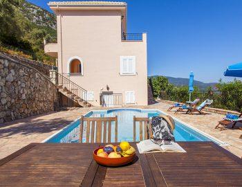 villa-poseidon-nikiana-lefkada-greece-outdoor-private-pool-area-with-dining-table