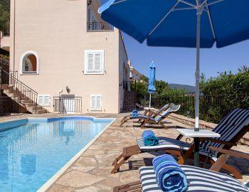 villa-poseidon-nikiana-lefkada-greece-sunbeds-umbrella-pool-view