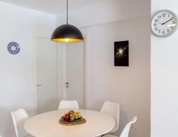 villa-selini-mikros-gialos-lefkada-greece-indoor-dining-setting