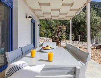 villa-selini-mikros-gialos-lefkada-greece-outdoor-dining-with-garden-view