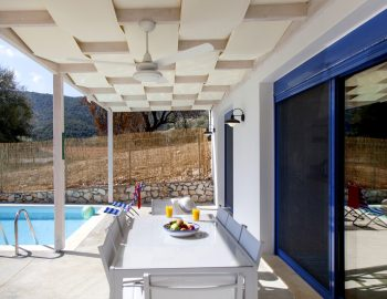 villa-selini-mikros-gialos-lefkada-greece-outdoor-dining-with-pool-view