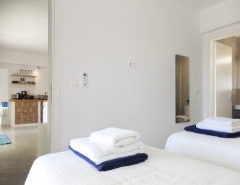 villa-selini-mikros-gialos-lefkada-greece-twin-bedroom-with-open-living-room-access