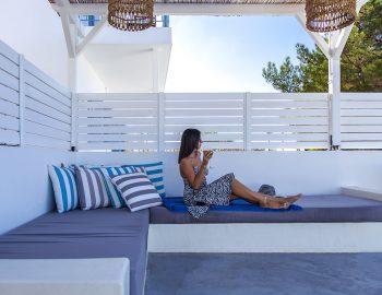 villa-sunset-kalamitsi-lefkada-greece-girl-relaxing-on-outdoor-seating-area
