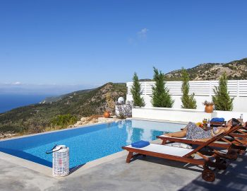 villa-sunset-kalamitsi-lefkada-greece-private-pool-with-girl-on-sunbed-and-exantheia-village-views
