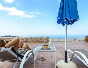 villa-vissala-arnebia-accommodation-lefkada-lefkas-girl-on-sunbed-with-sea-view