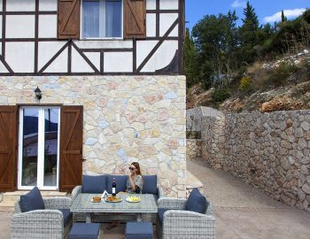 villa-vissala-arnebia-accommodation-lefkada-lefkas-xortata-girl-sitting-on-outdoor-furniture