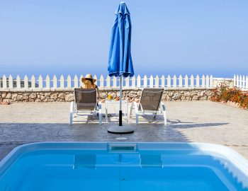 villa-vissala-minuartia-accommodation-lefkada-lefkas-xortata-private-pool-girl-sitting-on-sunbed