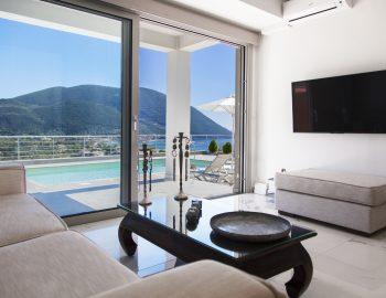 villa-w-offwhite-vasiliki-lefkada-greece-ground-floor-lounge-area-with-pool-and-sea-view