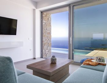 villa-zara-sunset-sivota-epirus-greece-living-room-couch-with-pool-view