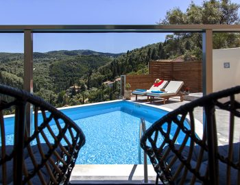 villa=alba-lefkada-greece-swimming-pool-area-with-sunbeds-and-seatings